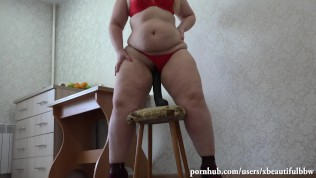 A young fat woman with a hairy pussy and a huge dildo, a hot video